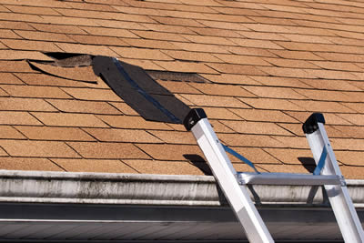 Roof that needs roof repairs with missing asphalt shingles